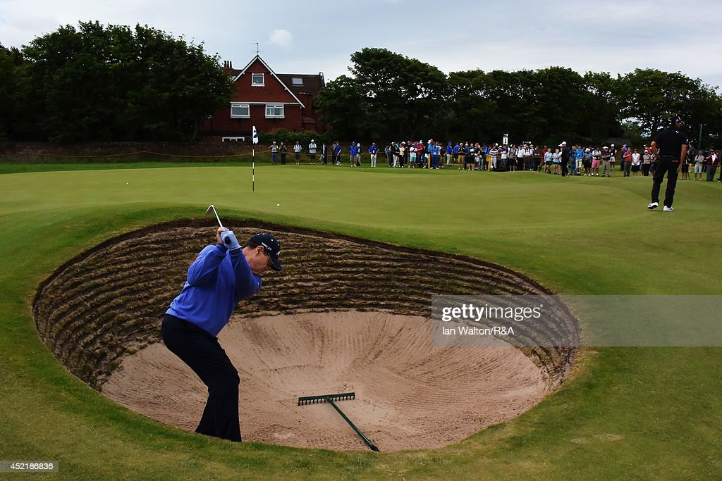 Tom Watson of the United States hits a shot from a greenside bunker during a practice round prior to the start of The 143rd Open Championship at Royal Liverpool on July 15, 2014 in Hoylake, England.