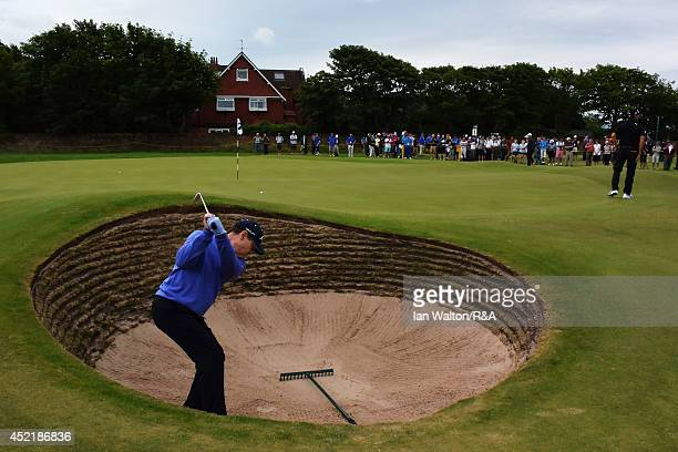 Tom Watson of the United States hits a shot from a greenside bunker during a practice round prior to the start of The 143rd Open Championship at...