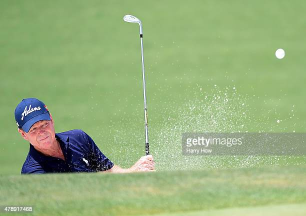Tom Watson of the United States hits out of the bunker on the 15th hole during round four of the US Senior Open Championship at the Del Paso Country...
