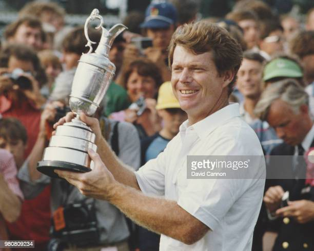 Tom Watson of the United States holds the slightly damaged Claret Jug trophy after winning the 112th Open Championship on 14 July 1983 at Royal...
