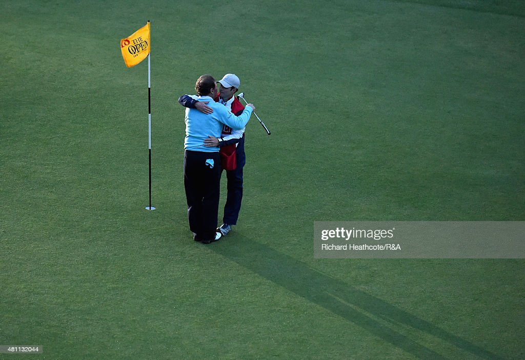 Tom Watson of the United States hugs his son and caddie Michael Watson after putting on the 18th green during the second round of the 144th Open Championship at The Old Course on July 17, 2015 in St Andrews, Scotland. This is Watson's last Open Championship.