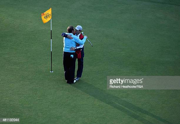 Tom Watson of the United States hugs his son and caddie Michael Watson after putting on the 18th green during the second round of the 144th Open...