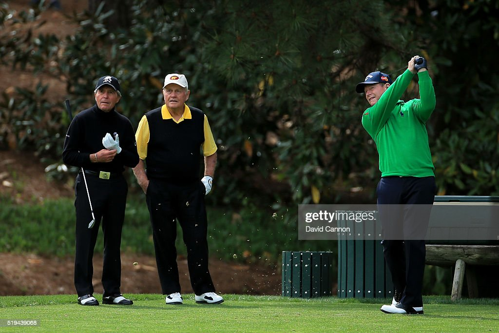 Tom Watson of the United States plays a shot as Jack Nicklaus and Gary Player look on during the Par 3 Contest prior to the start of the 2016 Masters Tournament at Augusta National Golf Club on April 6, 2016 in Augusta, Georgia.
