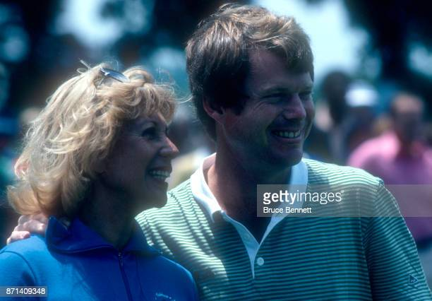 Tom Watson of the United States poses for a portrait with Dinah Shore during the Manufacturers Hanover Westchester Classic circa June 1982 at the...