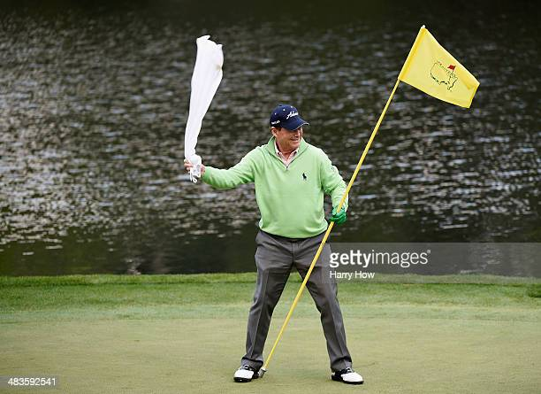 Tom Watson of the United States salutes the gallery on the ninth green during the 2014 Par 3 Contest prior to the start of the 2014 Masters...
