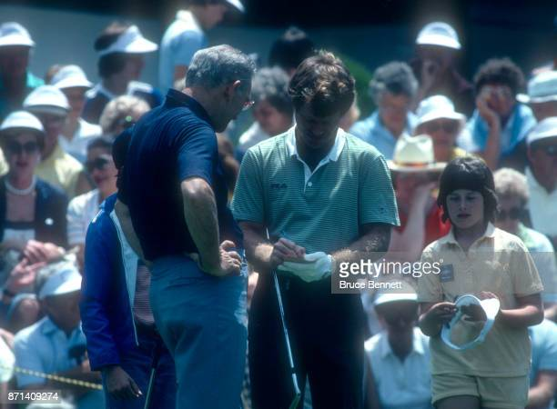 Tom Watson of the United States signs autographs for fans during the Manufacturers Hanover Westchester Classic circa June 1982 at the Westchester...