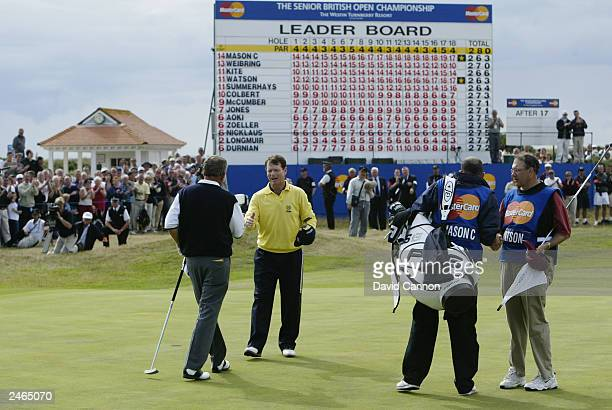 Tom Watson of the USA beats Carl Mason of England in the play-off during the final round of the Senior British Open presented by Mastercard held on...