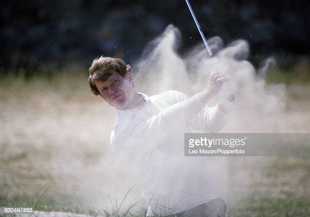Tom Watson of the USA blasts out of a bunker during the British Open Golf Championship at St Andrews circa July 1984
