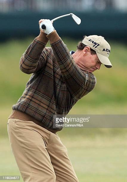 Tom Watson of the USA hits his 2nd shot on the 8th hole during the first round of The 140th Open Championship at Royal St George's on July 14 2011 in...