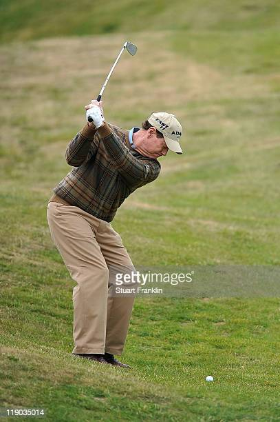 Tom Watson of the USA hits his 2nd shot on the 9th hole during the first round of The 140th Open Championship at Royal St George's on July 14 2011 in...