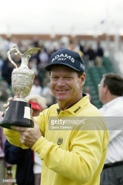 Tom Watson of the USA holds the trophy after beating Carl Mason of England in a play-off during the final round of the Senior British Open presented...