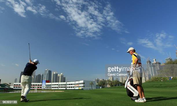 Tom Watson of the USA plays his second shot at the par 4 9th hole as a preview for the 2010 Omega Dubai Desert Classic on the Majilis Course at the...