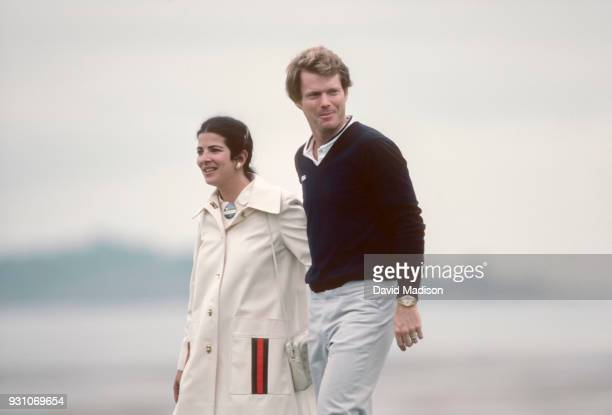 Tom Watson of the USA walks with his wife Linda Rubin Watson to the awards ceremony at the 18th green following the final round of the 1982 US Open...