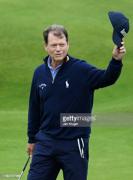Tom Watson of United States of America walks onto the 18th green in his final apprearance at a Senior Open during the final round of the Senior Open...