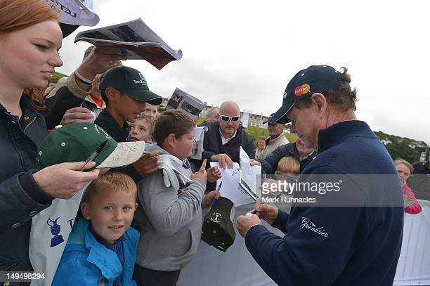 Tom Watson of United States signs autographs during the final round of the Senior Open Championship played over the Ailsa course at Turnberry on July...