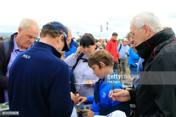 Tom Watson of United States signs autographs for fans during the third round of the Senior Open Championship presented by Rolex at Royal Porthcawl...
