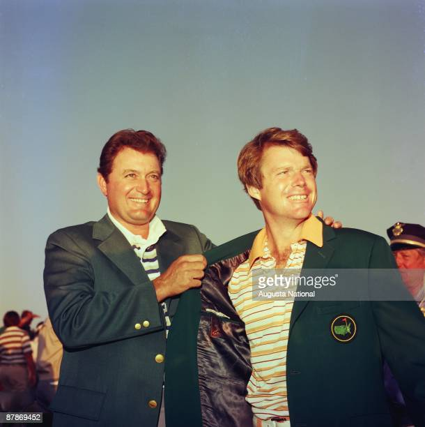 Tom Watson receives his first green jacket from Raymond Floyd after the 1977 Masters Tournament at Augusta National Golf Club in April 1977 in...