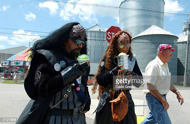 Tom Webster dressed as Klingon Lt K'Mach TaiTrekkan and Valerie Smith dressed as a Klingon ambassador enjoy their SnoCones during Trek Fest XIX June...