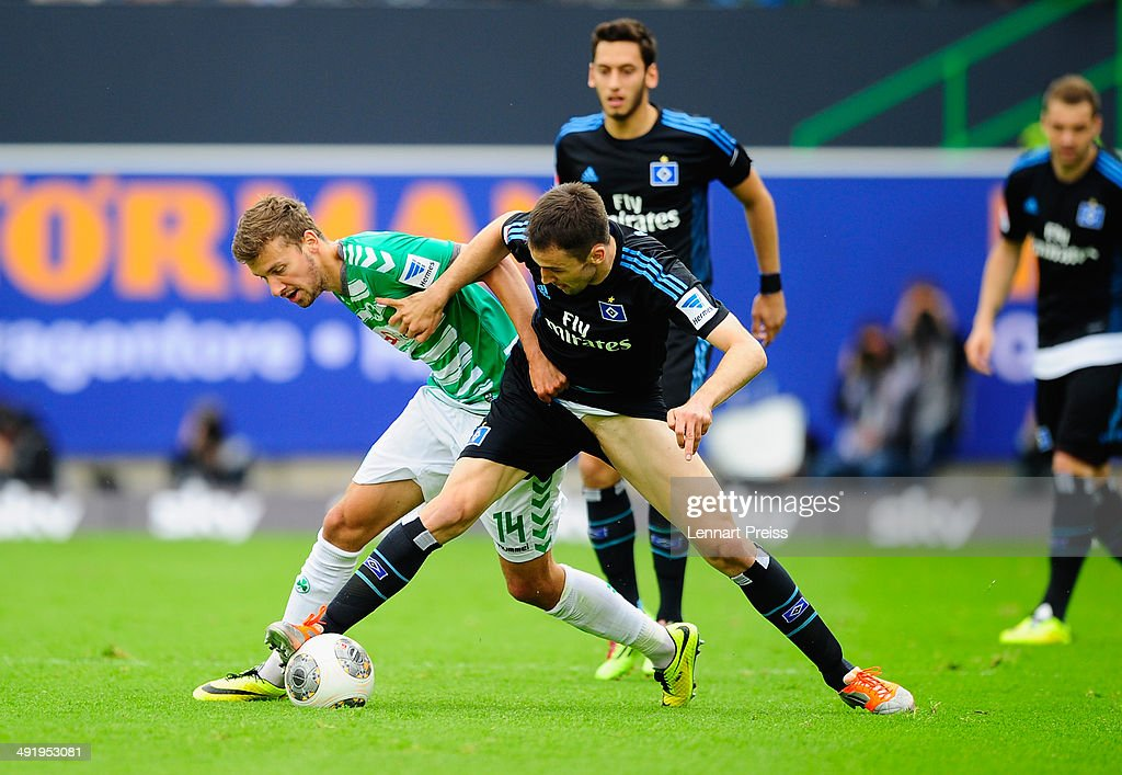 Tom Weilandt (L) of Fuerth challenges Milan Badelj (C) of Hamburg during the Bundesliga Playoff Second Leg match between SpVgg Greuther Fuerth and Hamburger SV at Trolli-Arena on May 18, 2014 in Fuerth, Germany.