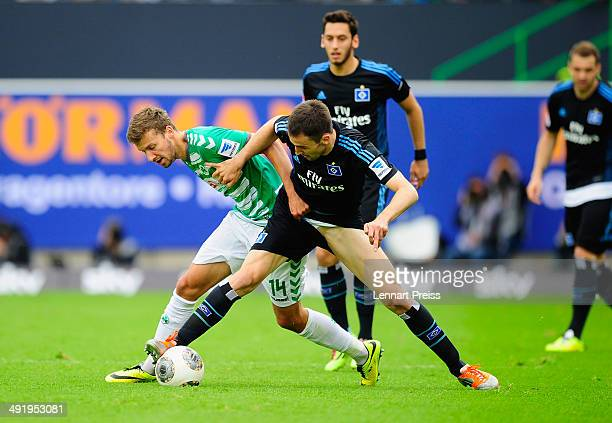 Tom Weilandt of Fuerth challenges Milan Badelj of Hamburg during the Bundesliga Playoff Second Leg match between SpVgg Greuther Fuerth and Hamburger...