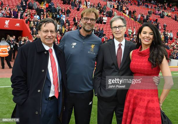 Tom Werner Chairman of Liverpool poses with Jurgen Klopp manager of Liverpool and John W Henry Principal owner with wife Linda Pizzuti at the end of...