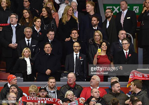 Tom Werner Mike Gordon and John W Henry owners of Liverpool Football Club watch from the Directors Box before the Barclays Premier League match...
