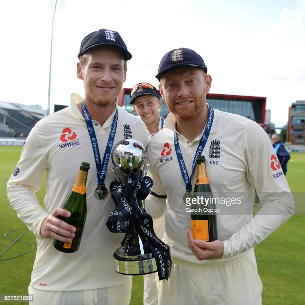 Tom Westley Joe Root and Jonathan Bairstow of England celebrate with the series trophy after winning the Investec Test series between England and...