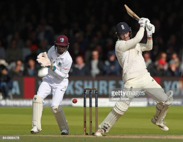 Tom Westley of England hits out as West Indies wicket keeper Shane Dowrich looks on during day three of the 3rd Investec Test match between England...