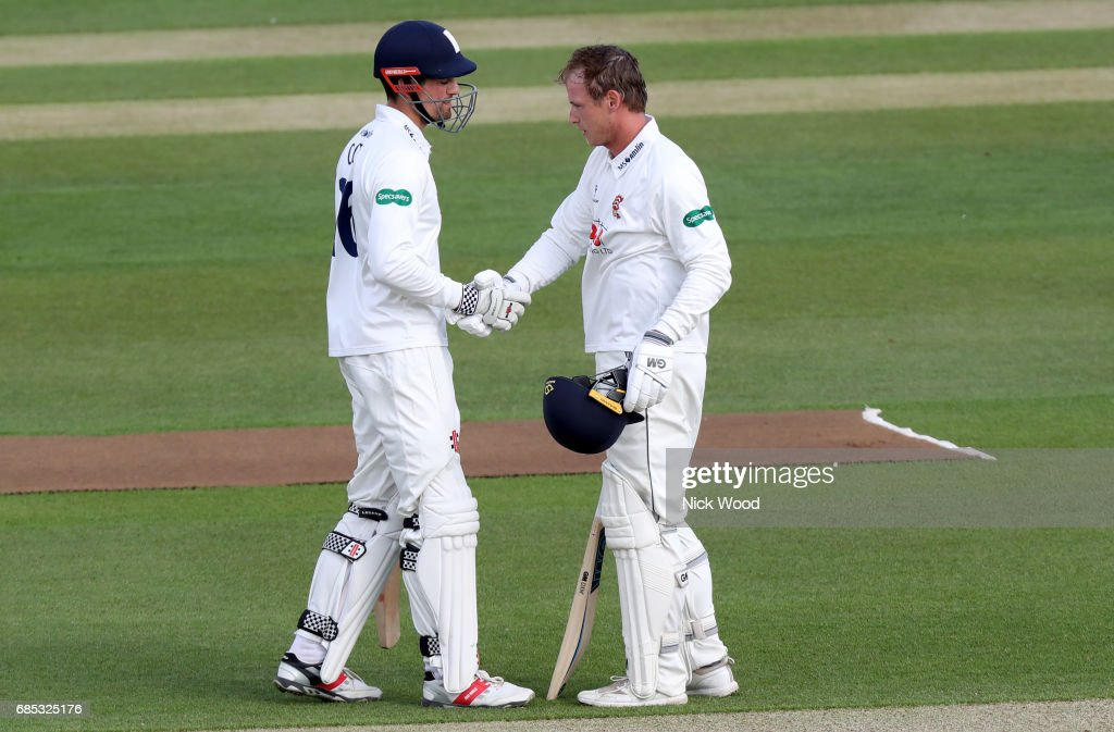 Tom Westley of Essex (r) and Alistair Cook shake hands to celebrate centuries during the Essex v Hampshire - Specsavers County Championship: Division One cricket match at the Cloudfm County Ground on May 19, 2017 in Chelmsford, England.