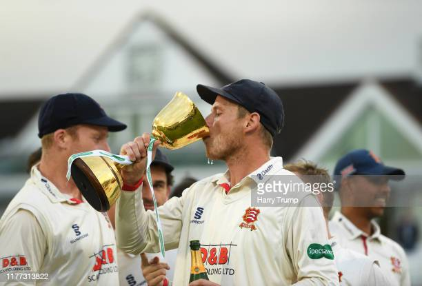Tom Westley of Essex drinks from the County Championship Trophy during Day Four of the Specsavers County Championship Division One match between...