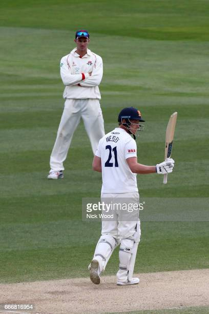 Tom Westley of Essex holds his bat aloft having scored fifty runs whilst batting at Cloudfm County Ground on April 10 2017 in Chelmsford England
