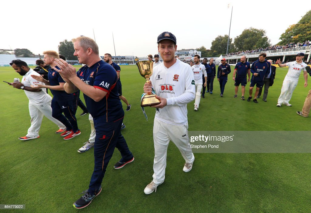 Tom Westley of Essex lifts the County Championship trophy during day three of the Specsavers County Championship Division One match between Essex and Yorkshire at the Cloudfm County Ground on September 27, 2017 in Chelmsford, England.