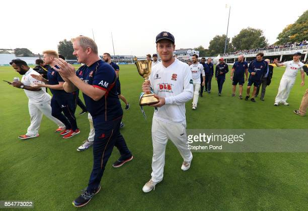 Tom Westley of Essex lifts the County Championship trophy during day three of the Specsavers County Championship Division One match between Essex and...