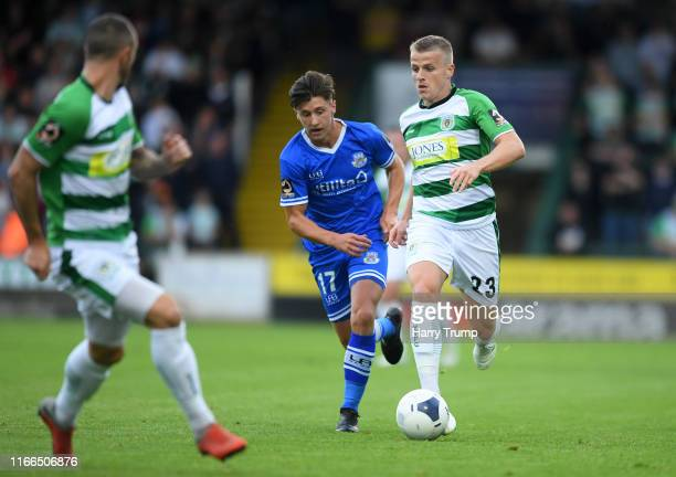 Tom Whelan of Yeovil Town looks to break past Cavanagh Miley of Eastleigh during the Vanarama National League match between Yeovil Town and Eastleigh...