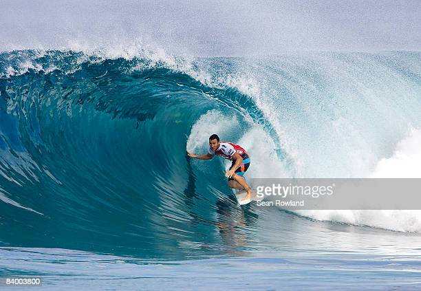 Tom Whitaker of Australia competes in the Vans Triple Crown Of Surfing event the Billabong Pipeline Masters at Banzai Pipeline on December 10 2008 in...