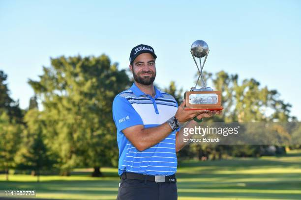 Tom Whitney of the United States poses with the official trophy after the final round of the PGA TOUR Latinoamerica 88 Abierto OSDE del Centro...