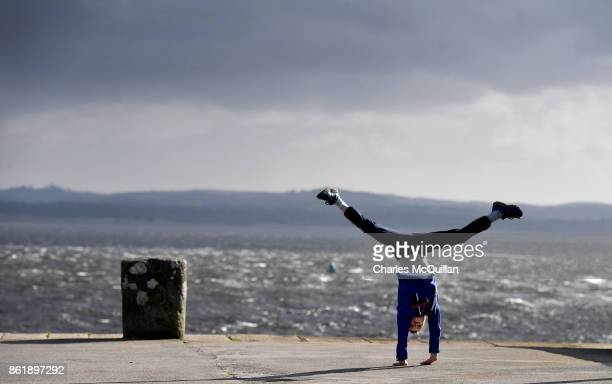 Tom Wickham cartwheels along Mount Charles pier after his school closed for the day ahead of Hurricane Ophelia on October 16 2017 in Donegal Ireland...