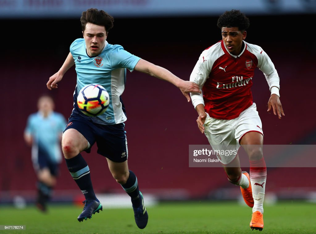 Tom Williams of Blackpool and Xavier Amaechi of Arsenal battle for possesion during the FA Youth Cup Semi Final 2nd Leg match between Arsenal and Blackpool at Emirates Stadium on April 16, 2018 in London, England.