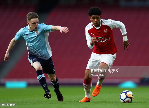 Tom Williams of Blackpool and Xavier Amaechi of Arsenal battle for possesion during the FA Youth Cup Semi Final 2nd Leg match between Arsenal and...