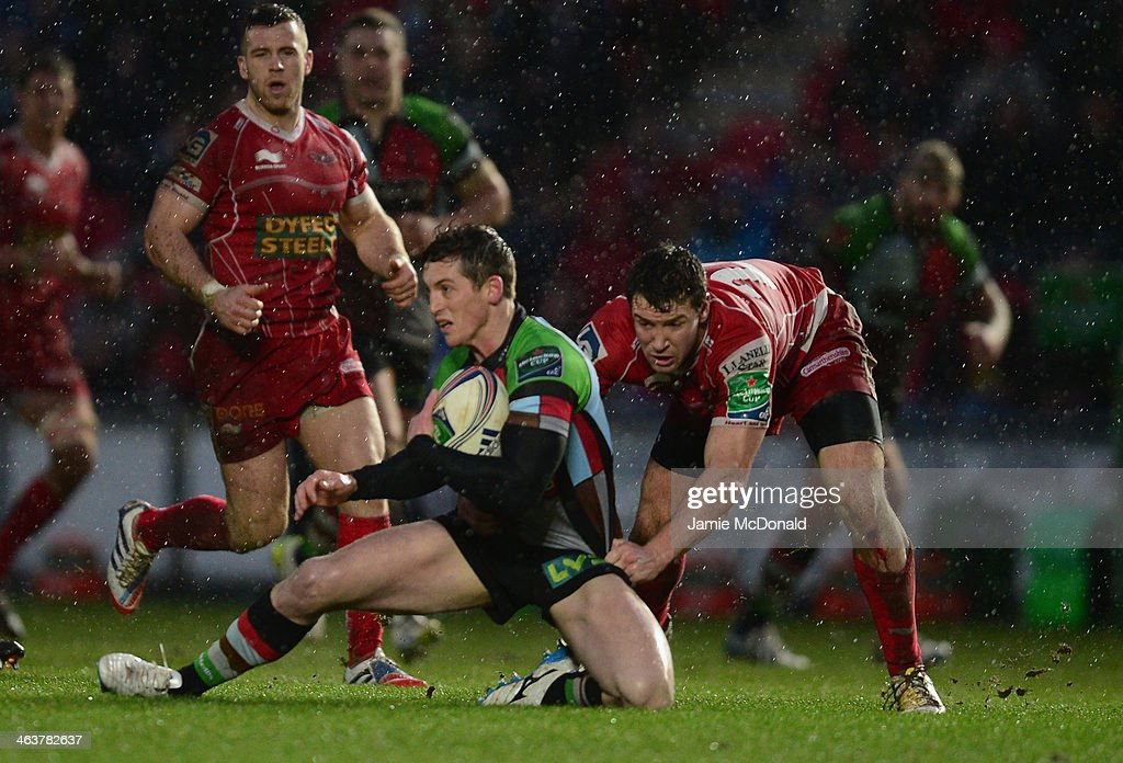 Tom Williams of Harlequins is tackled by Josh Turnbull of Scarlets during the Heineken Cup Pool 4 match between Scarlets and Harlequins at Parc y Scarlets on January 19, 2014 in Llanelli, Wales.