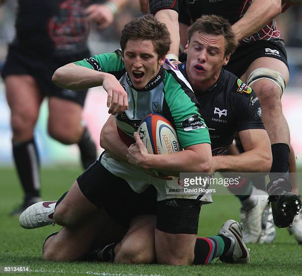 Tom Williams of Harlequins is tackled by Tommy Bowe during the EDF Energy Cup match between Ospreys and Harlequins at the Liberty Stadium on October...