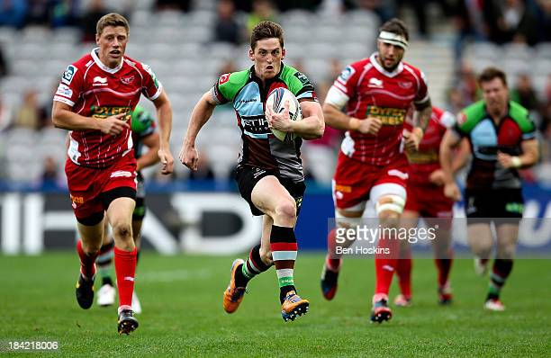 Tom Williams of Harlequins makes a break during the Heineken Cup match between Harlequins and Scarlets at Twickenham Stoop on October 12 2013 in...