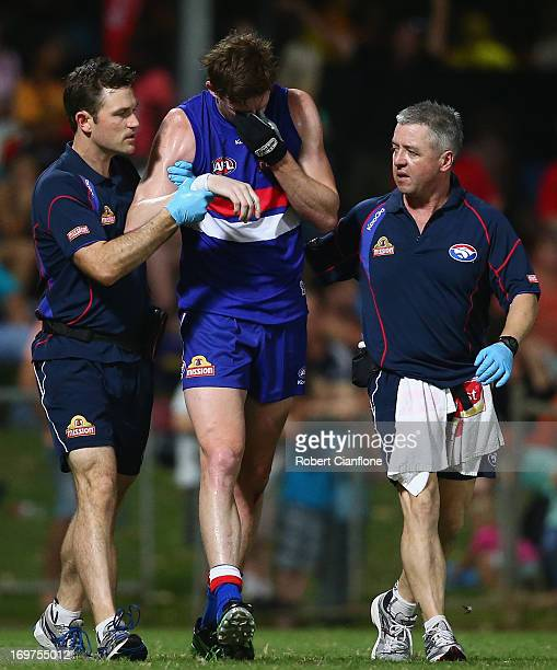 Tom Williams of the Bulldogs is taken from the gound with an injury during the round ten AFL match between the Western Bulldogs and Port Adelaide...