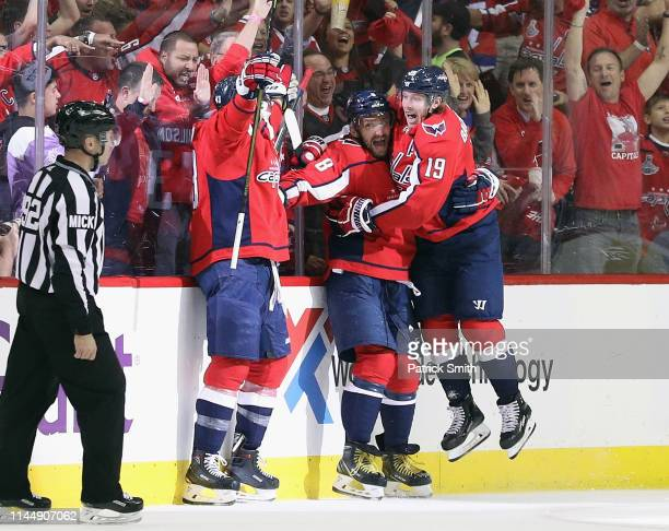 Tom Wilson, Alex Ovechkin and Nicklas Backstrom of the Washington Capitals celebrate Wilson's goal at 6:23 of the first period against the Carolina...