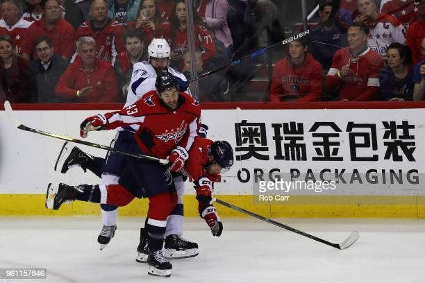 Tom Wilson and Lars Eller of the Washington Capitals skate against Victor Hedman of the Tampa Bay Lightning in the first period of Game Six of the...