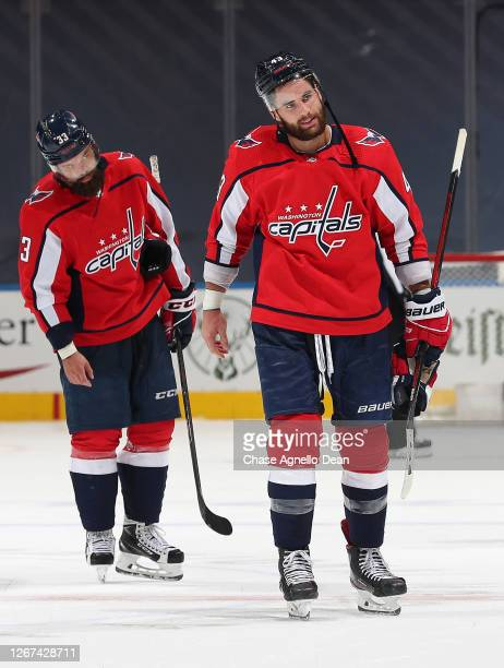 Tom Wilson and Radko Gudas of the Washington Capitals look on after their 40 loss in Game Five of the Eastern Conference First Round of the 2020 NHL...