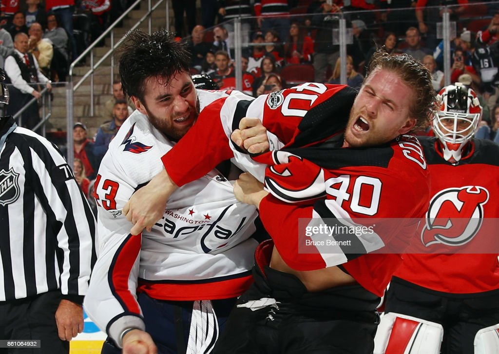 Tom Wilson #43 of the Washington Capitals and Blake Coleman #40 of the New Jersey Devils fight during the third period at the Prudential Center on October 13, 2017 in Newark, New Jersey. The Capitals defeated the Devils 5-2.