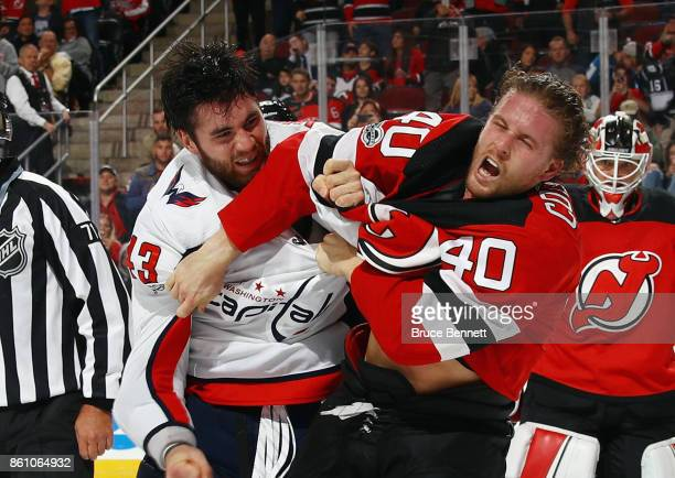 Tom Wilson of the Washington Capitals and Blake Coleman of the New Jersey Devils fight during the third period at the Prudential Center on October 13...