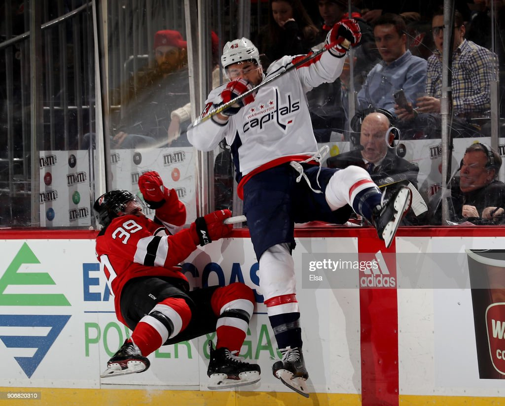 Tom Wilson #43 of the Washington Capitals and Brian Gibbons #39 of the New Jersey Devils collide in the second period on January 18, 2018 at Prudential Center in Newark, New Jersey.