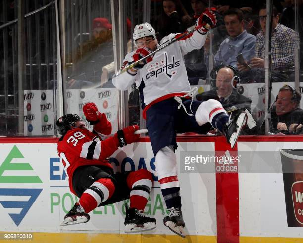 Tom Wilson of the Washington Capitals and Brian Gibbons of the New Jersey Devils collide in the second period on January 18 2018 at Prudential Center...